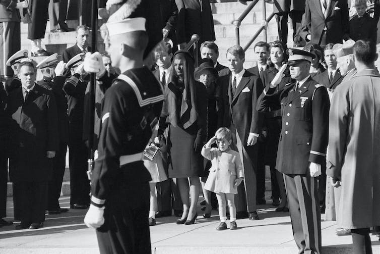 John F. Kennedy Jr. salutes as the casket of his father, the late President John F. Kennedy, is carried from St. Matthew's Cathedral in Washington, DC.