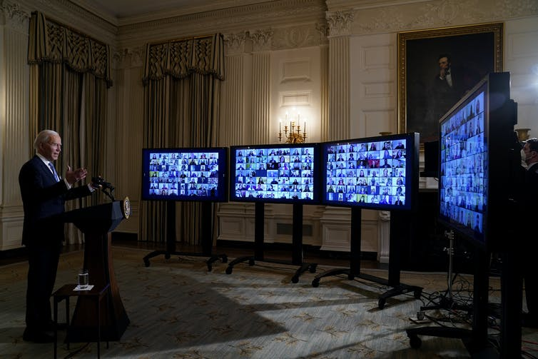 US President Joe Biden swears in political appointees in a virtual ceremony on January 20 2021.
