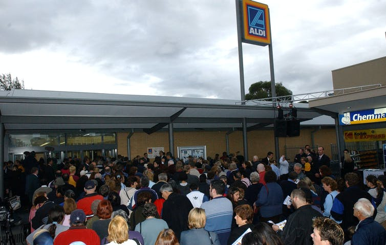 Shoppers queue for bargains at Aldi's store in Heidleberg West, Melbourne.