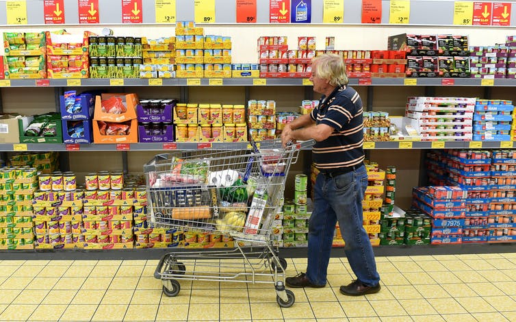Older man shopping in Aldi store on the Gold Coast, Queensland.