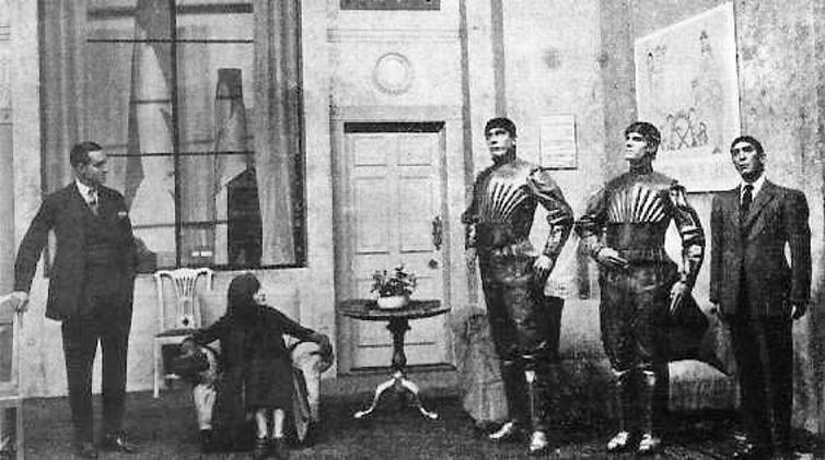 A black and white image of three robots, a woman and a man.