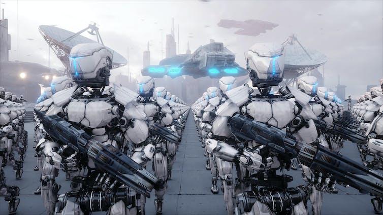 Menacing robots holding guns.