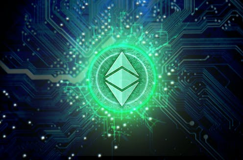 The ethereum logo glowing green on a circuit