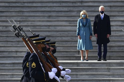 Joe and Jill Biden inspect the troops at the U.S. Capitol.