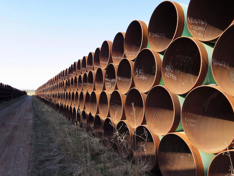 A row of rust-coloured pipes