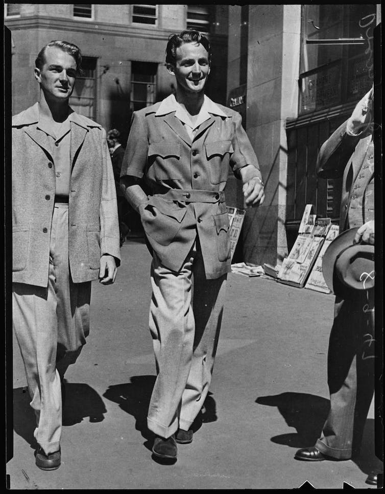 Two men in suits in 1947.