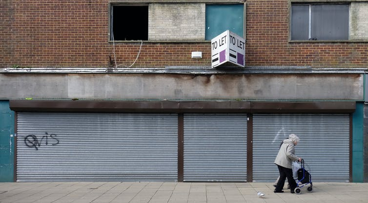 boarded up shop in Waterlooville, Hampshire UK due to rent increase and declining shopping on Britain's high streets.