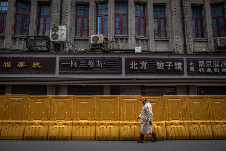 A fence between neighbourhoods in Wuhan during its first lockdown.