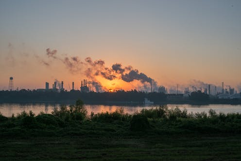 Smoke rises from chemical plants along the Mississippi River