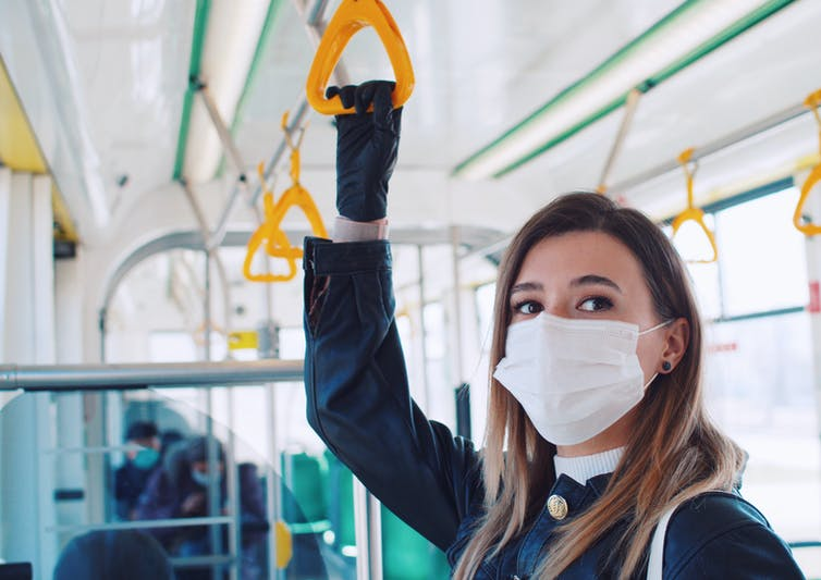 Student on a city bus.