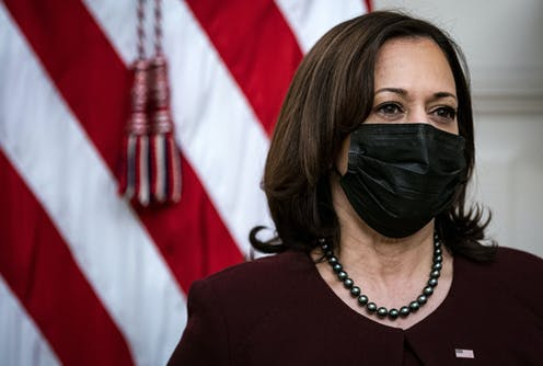 Vice President Kamala Harris wearing face mask in front of US flag