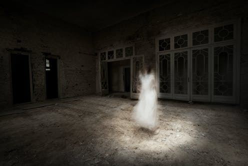 A ghostly figure of a girl in a dark room with rubble on the floor