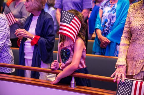 Congregants at First Baptist Dallas church celebrate Freedom in Dallas, Texas on Sunday, June 30, 2019.