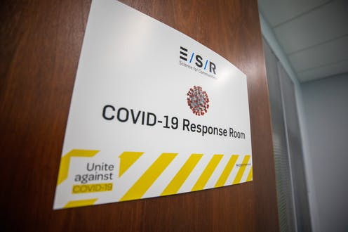 Sign on door saying 'COVID-19 response room'