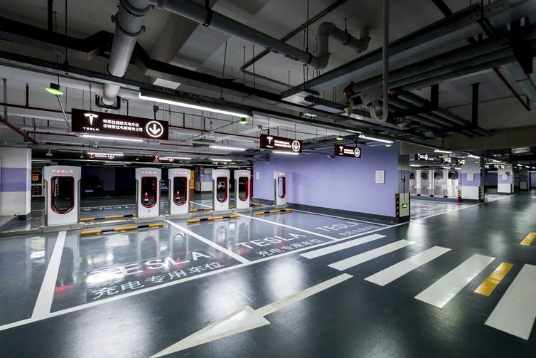 Tesla's 'supercharger station', in the car park of a Shanghai office complex, is the largest yet built, with capacity for 72 vehicles.