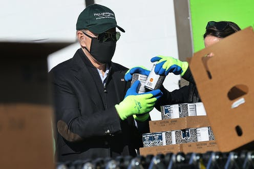 Joe Biden helps volunteers fill food donation boxes at the Philabundance food bank during the Martin Luther King National Day of Service on January 18, 2021 in Philadelphia, Pennsylvania.