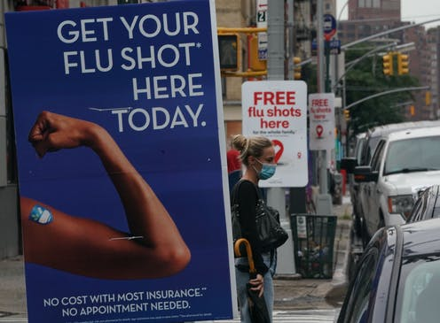 posters advertise flu shots