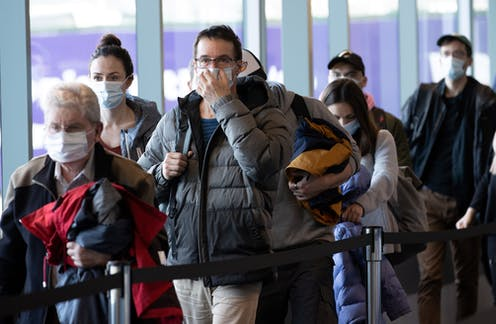 Airport passengers in masks