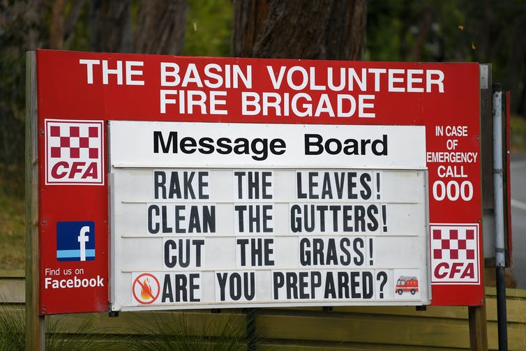 A fire station noticeboard that reads 'rake the leaves, clean the gutters, cut the grass, are you prepared?'