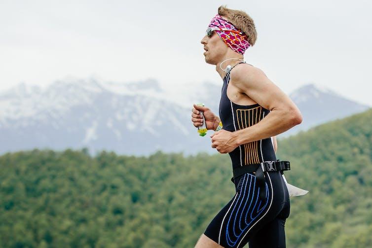 Runner consuming an energy gel