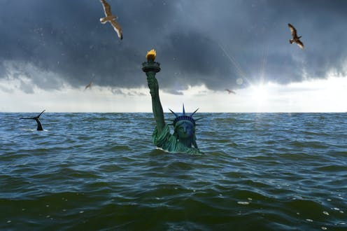The Statue of Liberty pokes above the raised sea.