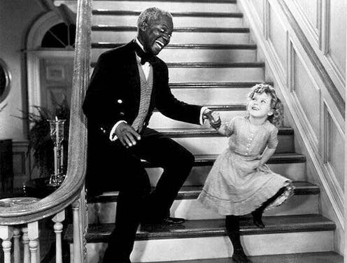 Bill and Shirley dancing on a staircase.