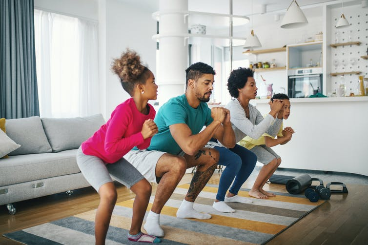 parents and kids working out at home together