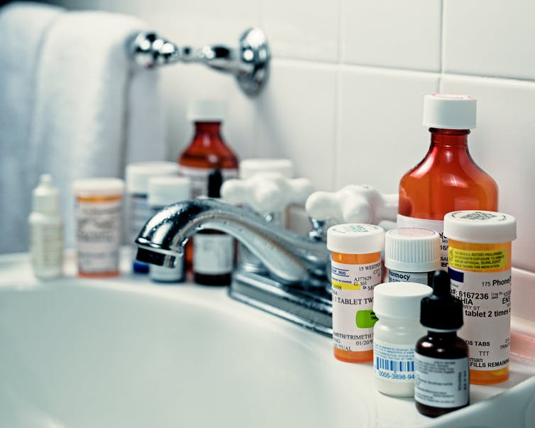 Many prescription medications around bathroom sink