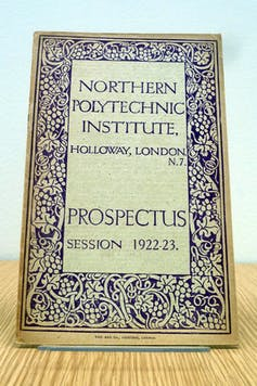 Cover of old prospectus, with college name in large letters, surrounded by decorative border.