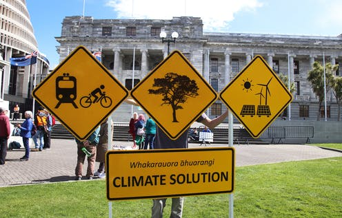 Banners calling for climate solutions