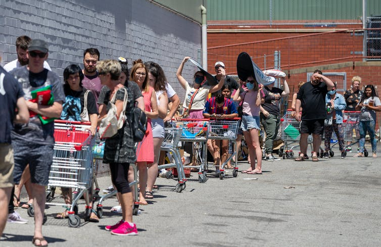 Shoppers queue outside a supermarket in Maylands, Perth