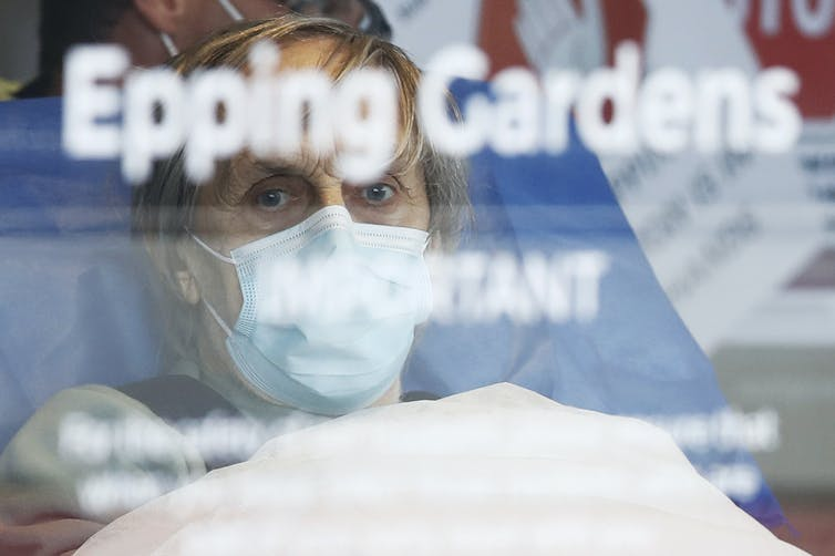 Aged Care resident taken away in an ambulance from Epping Gardens Aged Care Facility in Melbourne.