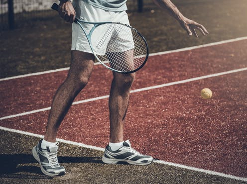An unknown tennis player shown only from chest down.