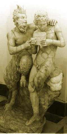 A stone statue of Pan and Daphnis, half humans half goats.