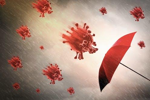 Dibujo de un paraguas rojo sobre el que se precipitan virus