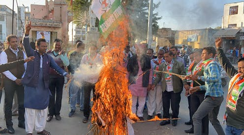 Indian farmer protesters burn effigy of Prime Minister Modi in the street