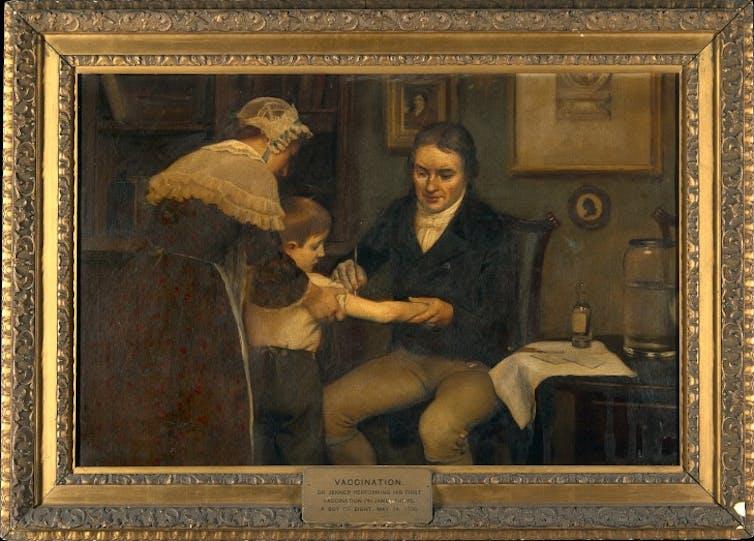 Cuadro que representa a Jenner realizando su primera vacunación en James Phipps, un niño de 8 años, el 14 de mayo de 1796 (Ernest Board, circa 1910). Wikimedia Commons