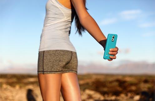 Fitness model taking selfie