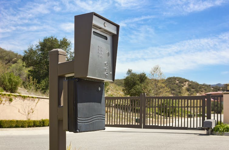 An intercom at the entrance of a gated community.