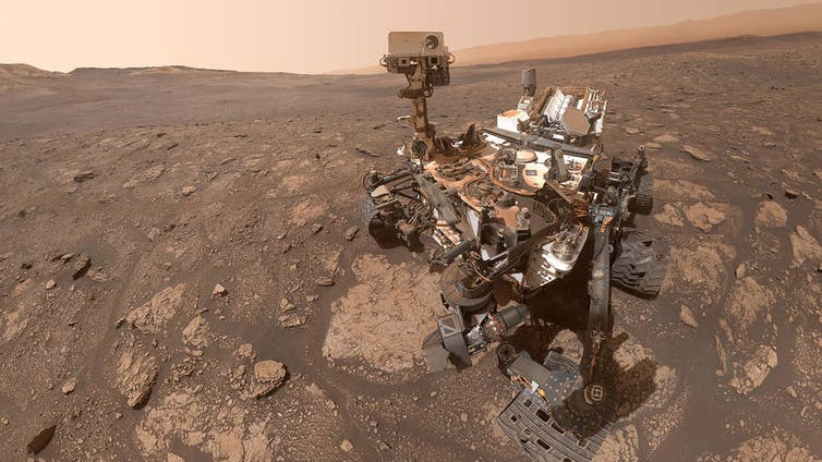 The Curiosity rover on the Martian surface.