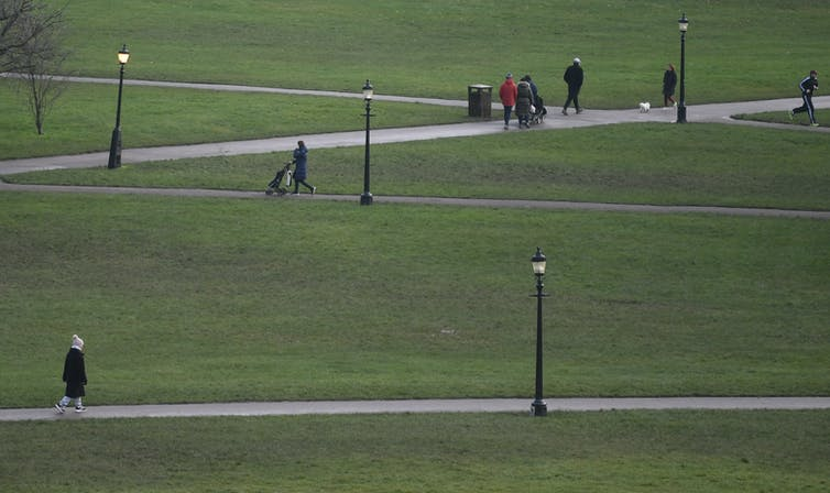 People walk in a park