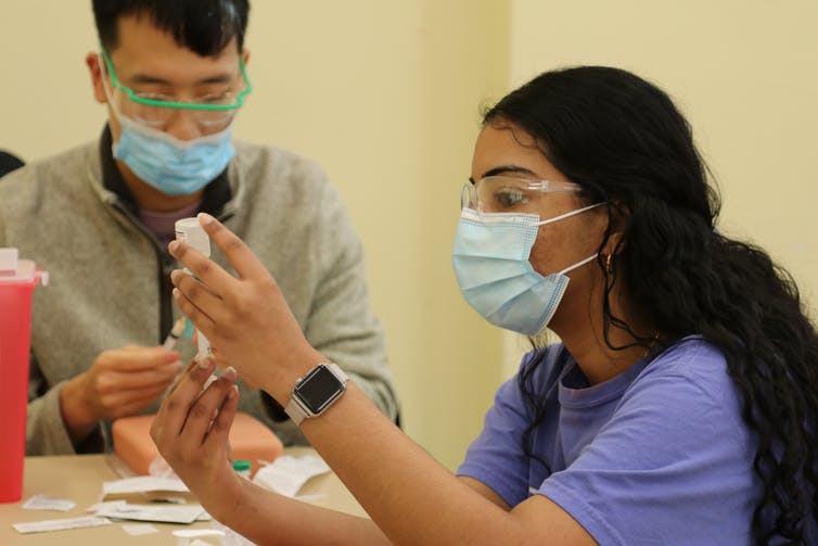 Students practice vaccination techniques