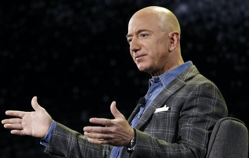 Jeff Bezos speaks at a conference.