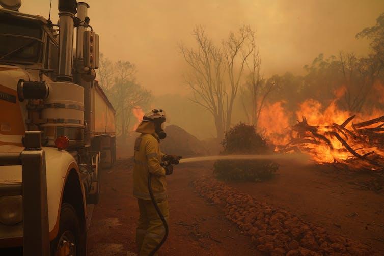 Firefighters battle flames in Western Australia.