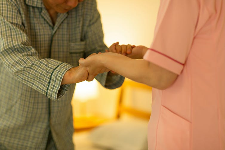 Aged care worker with elderly man.