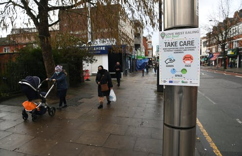 A government coronavirus notice is displayed in Ealing, London, warning people to 'Take Care'.