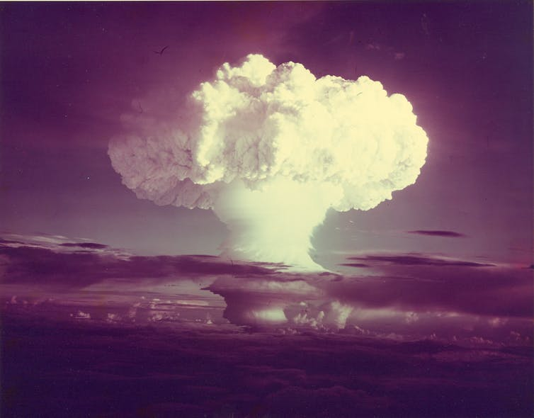 A large mushroom cloud captured on old film cameras
