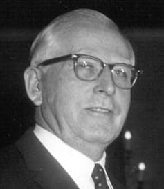 Headshot of a middle-aged white man wearing glasses.