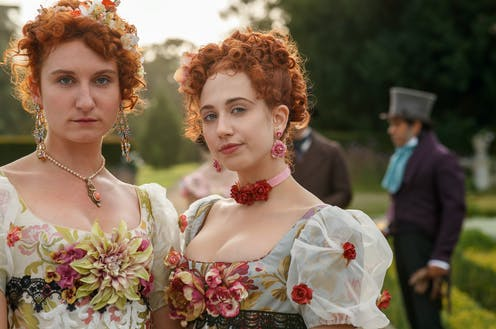 Two women in period costumes.