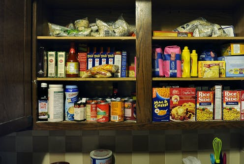 A cupboard stocked with dried beans and other affordable and nutritious food.